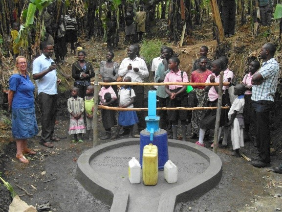 community gather at new borehole