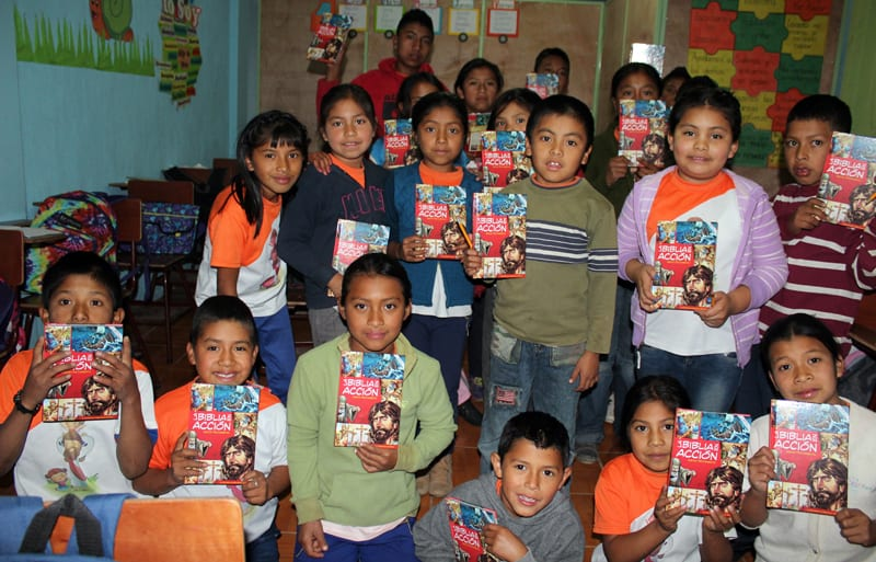Illustrated Action Bibles for children at a school