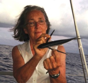10. Anne with one of many flying fish that were found some mornings on Joyful's decks.