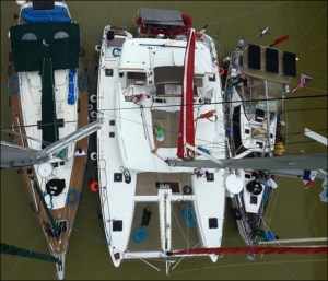 13. Dunbar's super photo he took of Joyful, Aventura, and a catamaran rafted together to transit the Panama Canal locks on both days. He went to the tope of Aventura's mast to take this photo. Thank you, Dunbar!