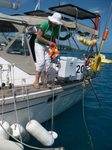 21. Flat Mr. Davis, seen right next to Anne and the orange meter reel, helped Anne as she lowered Joyful's Secchi disk into the lagoon at Bora Bora.  Fifth grade science students from Round Hill Elementary School kindly made the Secchi disk for Joyful.