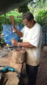 38. Emmanuel's father, a master woodcarver from Nuku Hiva, used modern and traditional tools to create works of art from Nuku Hivan trees.