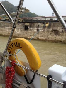 53. Joyful's floating line was secured on land ready for the water in the Pedro Miguel lock to be released.
