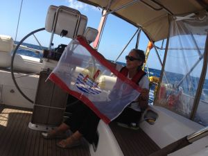 58. Anne finished sewing the edges of the French Polynesian courtesy flag she constructed for Joyful.