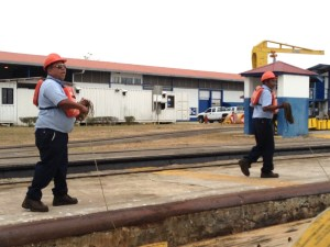 64. Joyful's land based line handlers walked Joyful up to the lock through location for the upper Miraflores Lock.