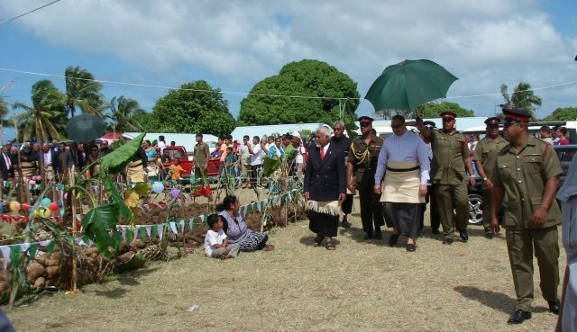 15. The King of Tonga and his entourage survey the ample bounty of this productive island kingdom
