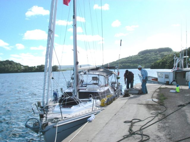165. At the custom's dock, Jeff and Bill prepare Joyful's dinghy for stowage for the passage to Vanuatu