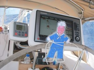 12. Flat Mr. Davis is at the helm steering Joyful toward her next landfall of Vanuatu. Joyful uses electronic charts as well as traditional paper charts for the whole world
