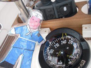 36. Flat Mr. Davis loves Joyful's ship's compass. It has a light, which we turn on at sundown while underway