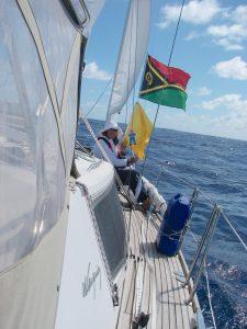 55. Flat Mr. Davis and Anne hoist the Republic of Vanuatu courtesy flag and the yellow Q flag as Joyful sails into Vanuatu national waters