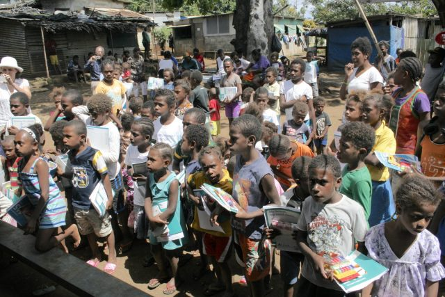 63-some-of-the-141-children-await-their-school-supply-kits-all-180-children-in-the-village-received-kits