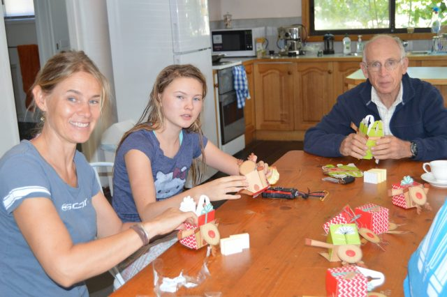 120. Beatrice, Gabriella, and Jeff helped assemble Christmas presents for the elder care home on Phillip Island, Australia. We gave the residents the gifts during the art ministry event