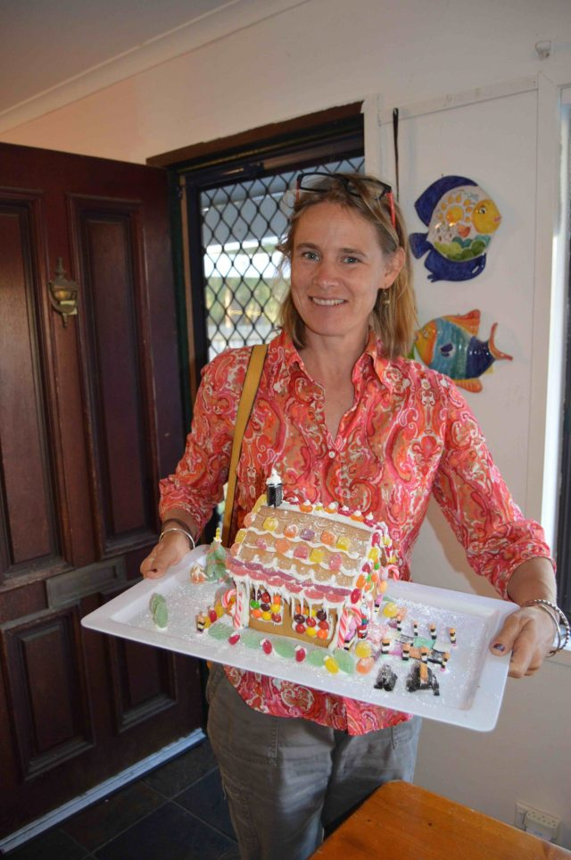 124. Beatrice and the cheerful gingerbread house she made. Beatrice will kindly give the gingerbread house to an elder care center on Phillip Island.