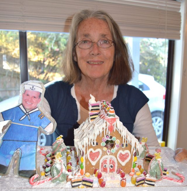 134.1. Flat Mr. Davis and Anne with the gingerbread house they made for residents of an elder care center on Phillip Island, Australia
