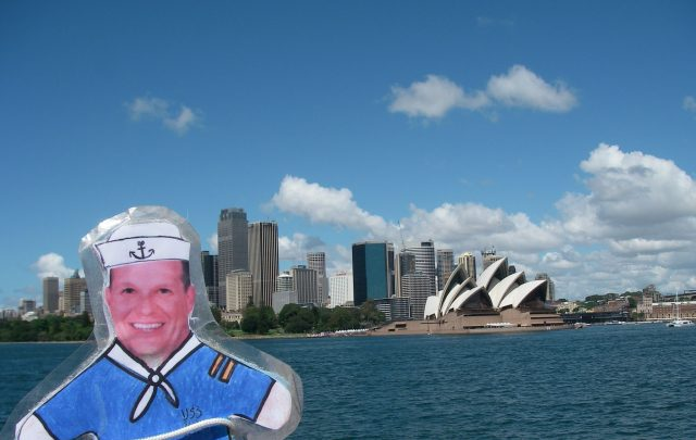 38. Flat Mr. Davis approaches Sydney from a ferry boat.