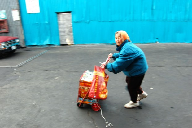 A woman makes her way through the Paper Rush Co. recycling center.