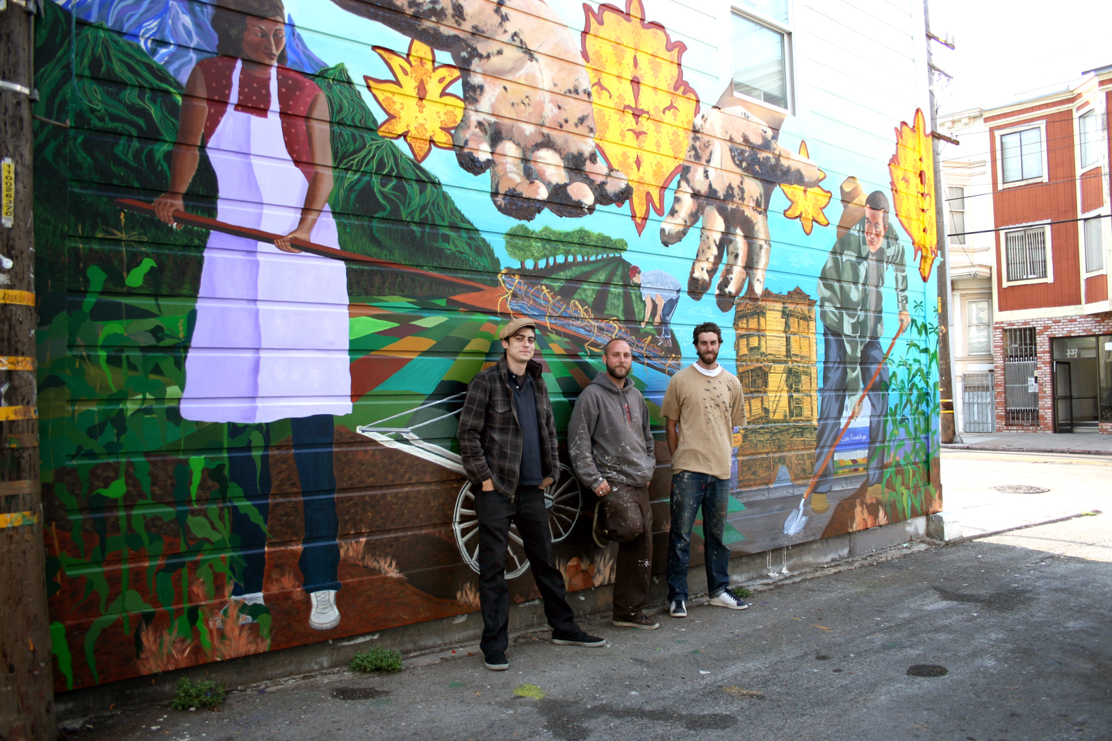 Christo Oropeza, Brian Perrin and Max Allbee of SPAC stand in front of their Mission Pie mural.