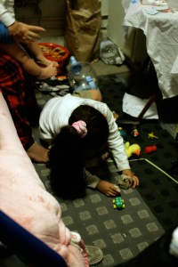 Shirley plays on the floor.
