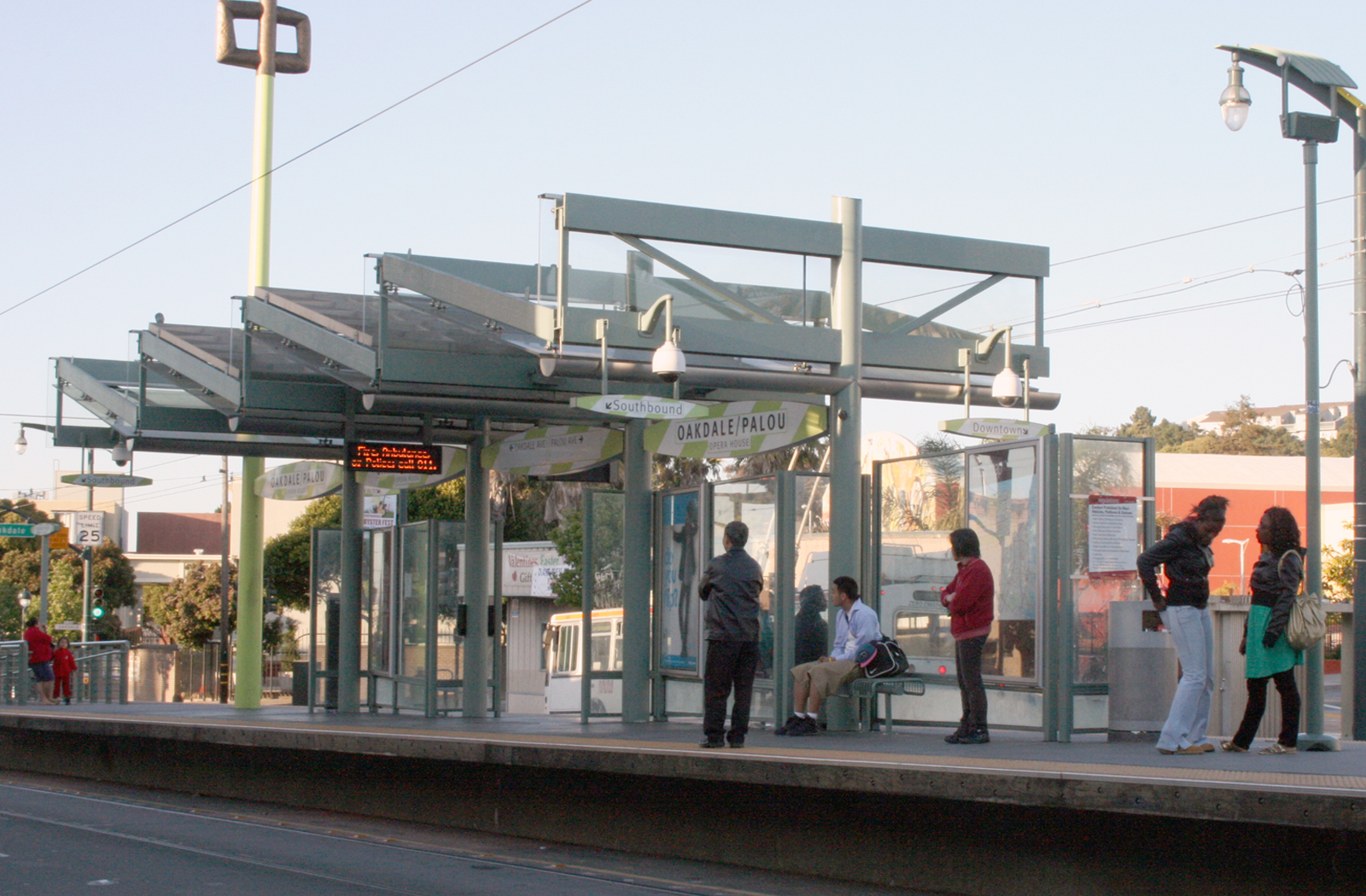 Riders wait for Muni at Third Street and Palou Avenue around 7:30 p.m.