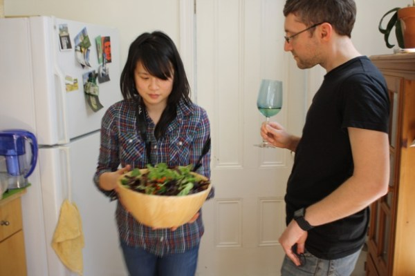 Yau carries a salad into the dining room. This particular one is bug-free.