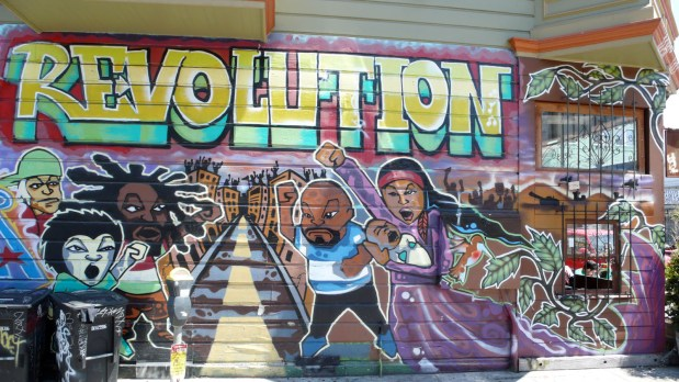 Original Revolution Mural damaged in a fire. Photo by Dennis Kernohan