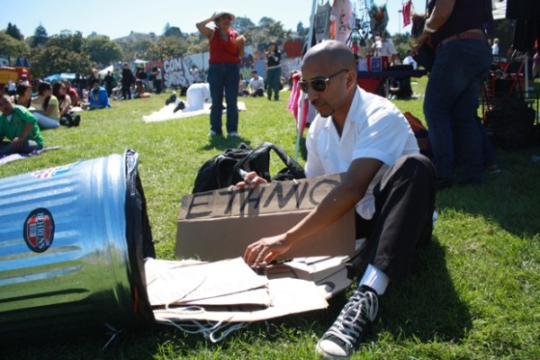"""At the celebration of the 40th Anniversary of the Chicano Moratorium, Luis """"xago"""" Juarez prepares for a performance by Head Rush Crew Teatro Troop."""
