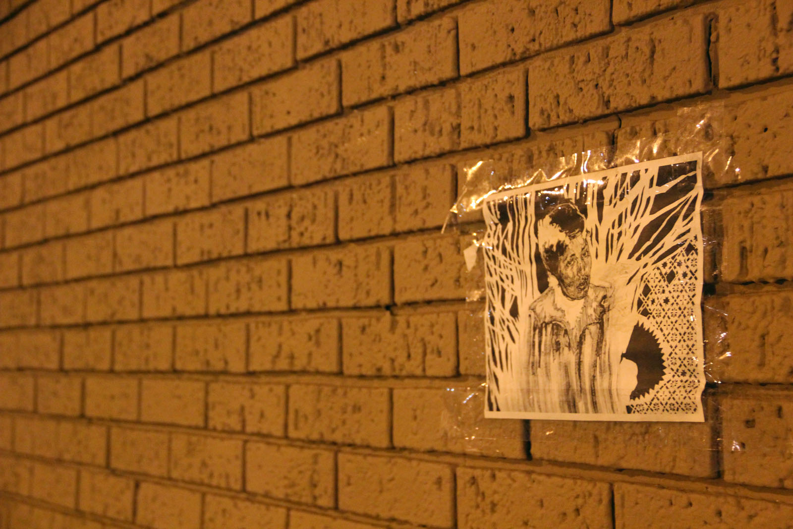 A small copy commemorating Swoon's piece is all that remains on the outside wall of Tony's Market at 24th Street and Hampshire.