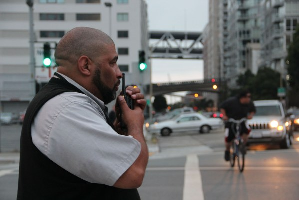 Sean Thomas of AC Transit directs bus traffic at the temporary SF transbay terminal in SOMA. He said up to 20 bus lines were thrown off schedule by the chaos caused by Friday's Critical Mass ride. Photo by Mateo Hoke.