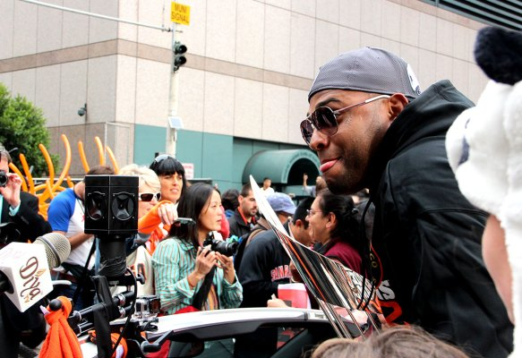 Pablo Sandoval rides on his car at the Giants parade. Photo by Chelsi Moy.