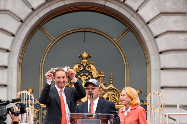 Mayor Ed Lee presents Giants Chief Executive Officer Larry Baer with a key to the city. Photo by Rigoberto Hernandez.