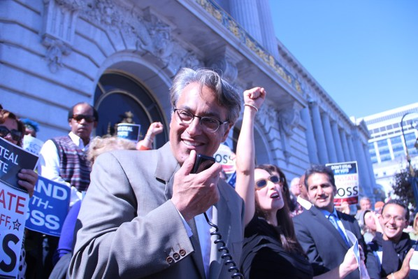 Sheriff Ross Mirkarimi addresses a rally of his supporters as his wife, Eliana Lopez, cheers him on before the Board of Supervisors' hearing on whether or not to suspend him permanently.