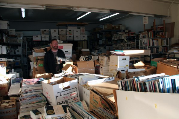 """Profession Packer"" Bill Taylor, also a widely published poet, in Bolerium's storage room on the second floor."