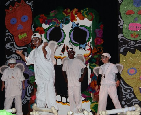 Students dressed as angels performed an original choreographed dance at the beginning of the play. Photo by Erica Hellerstein.