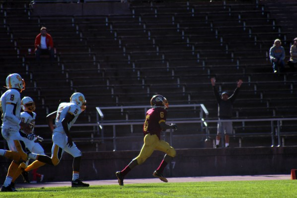 Demetrius Williams of Lincoln High scores a touchdown in the first half of the city's football championship on Thursday,