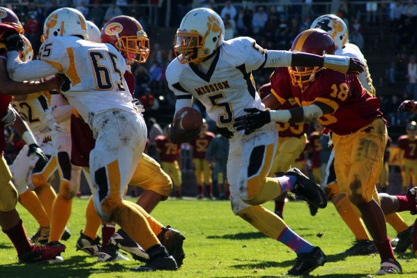 Antoine Porter of Mission High runs past the Lincoln High defense during the Turkey Game on Thursday.