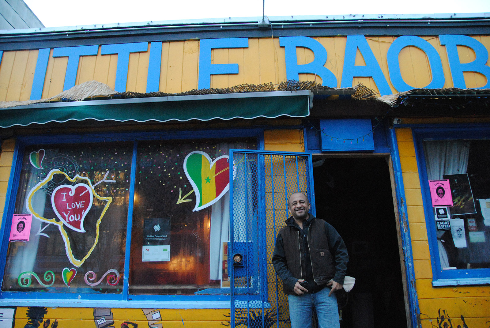 Image shows Marco Senghor outside his restuarant.