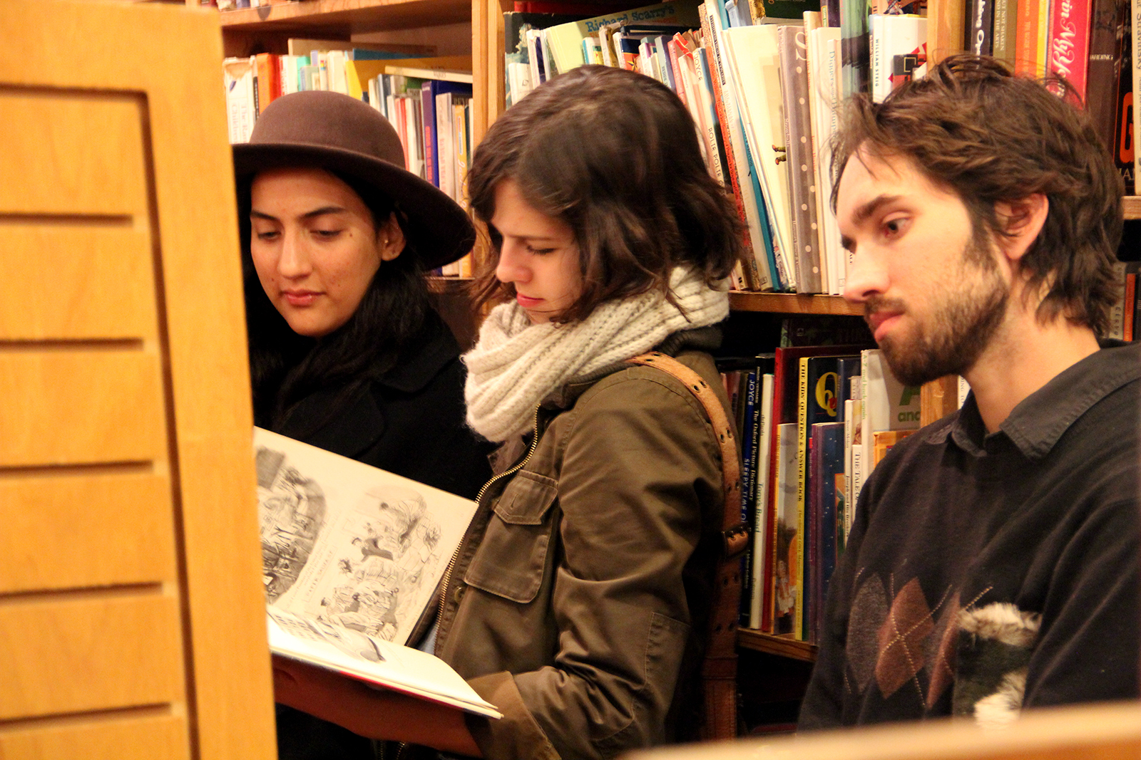 """People filled the store on the night of """"A Celebration of Adobe Bookshop,"""" and browsed the collection of books after the readings. Photo by Molly Oleson"""