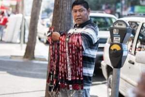 Benjamin Juarez sells lanyards on Mission Street. Juarez drives from San Jose to sell in the streets of the Mission(Photo by: Lauren Kate Rosenblum)