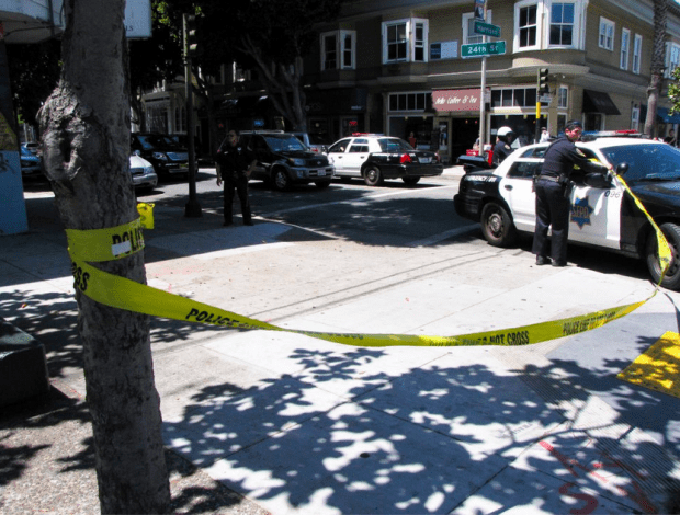 Police close off the corner of 24th and Harrison streets after a masked gunman opened fire last year. File photo by Francisco Barrada.