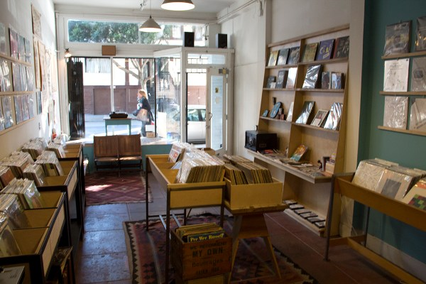 """Books, too: """"Books and records go together like grilled and cheese, chocolate and milk, and bacon and everything,"""" said owner Chris Dixon."""