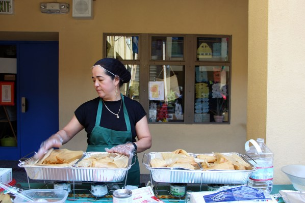Reyna Aguilar, 42, keeps her Mexican-American tamales warm throughout the contest.