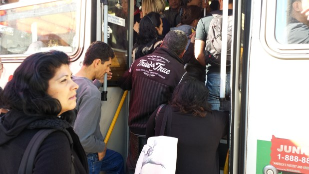 A horde of people filed onto the 14-Limited bus at Mission and 24th Street on Day 1 of October's BART strike. Photo by Courtney Quirin.
