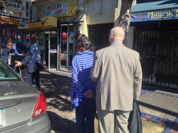 A woman was detained around 1 p.m. today on Mission Street. Photo by Emily Gibson.