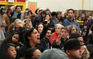 Crowd shouts in anger at community meeting in response to police shooting on Alejandro Nieto.
