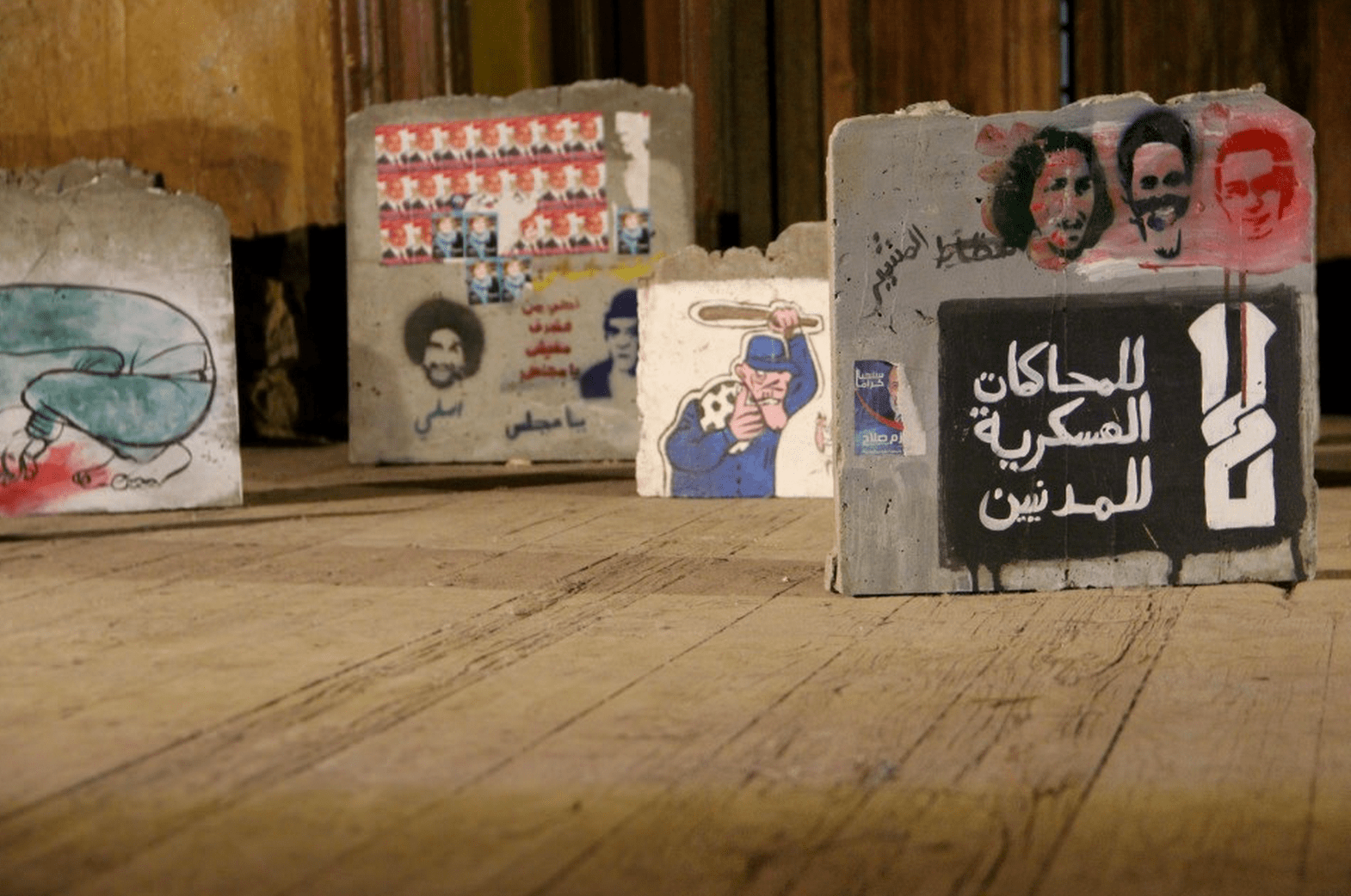 Photo by Rowan El Shimi (Flickr) of the Horreya Exhibition, 2012. Born from a conversation between visual artists Ganzeer and Hany Rashed in 2012, the exhibition also features graffiti and installation works by Ammar Abu Bakr and Ahmed Hefnawy.