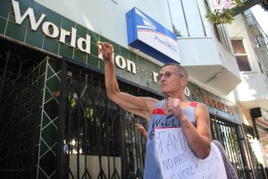 Buck Bagot gesturing in support of Sergio during the closing statements outside of the Fong's four properties on the corner of 24th and Bryant, one of them Sergio's apartment. Photo by Joe Rivano Barros.