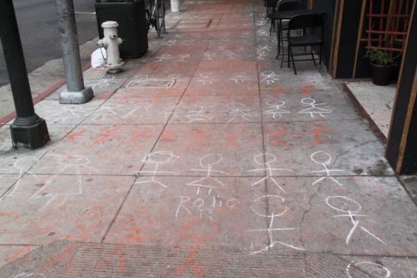 The memorial went down 24th St. from the BART Station to Folsom, though foot traffic soon wiped much of the chalk away. Photo by Joe Rivano Barros.