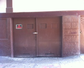 The garage door that opens to a basement that hosts an unoccupied illegal unit in the back.