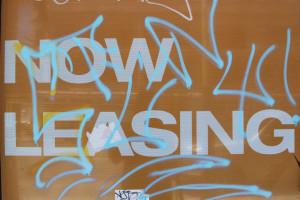 Graffiti mars a real estate poster at the Vara  project. Photo by Daniel Hirsch.