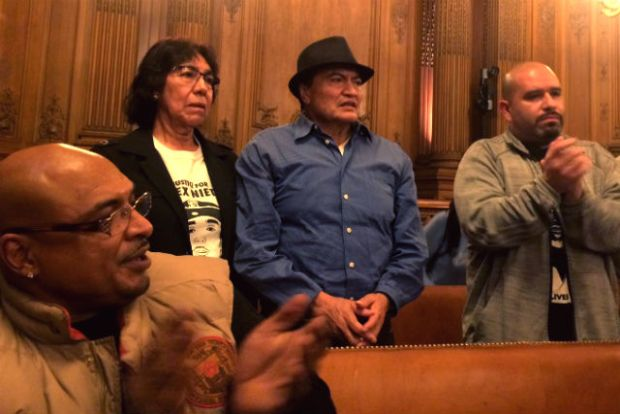 Elvira and Refugio Nieto (second to left and center), listen as the Board of Supervisors call for a federal investigation into the 2014 officer involved-shooting of their son, Alex Nieto. Photo by Laura Waxmann